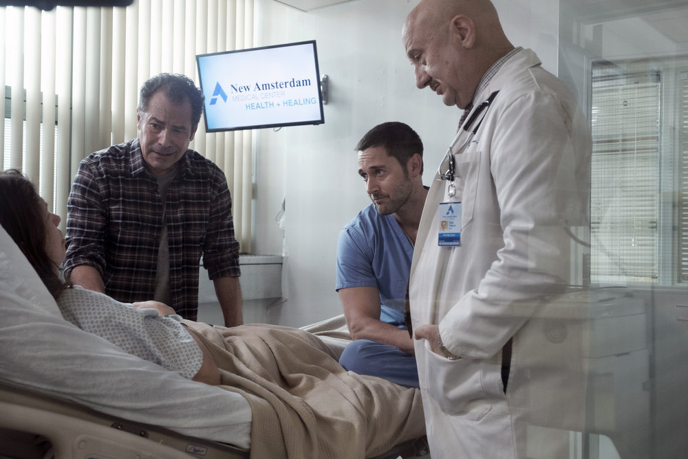 "NEW AMSTERDAM -- ""Pilot"" Episode 101 -- Pictured: (l-r) Gary Perez as Carlos, Ryan Eggold as Dr. Max Goodwin, Anupam Kher as Dr. Vijay Kapoor -- (Photo by: Francisco Roman/NBC)"