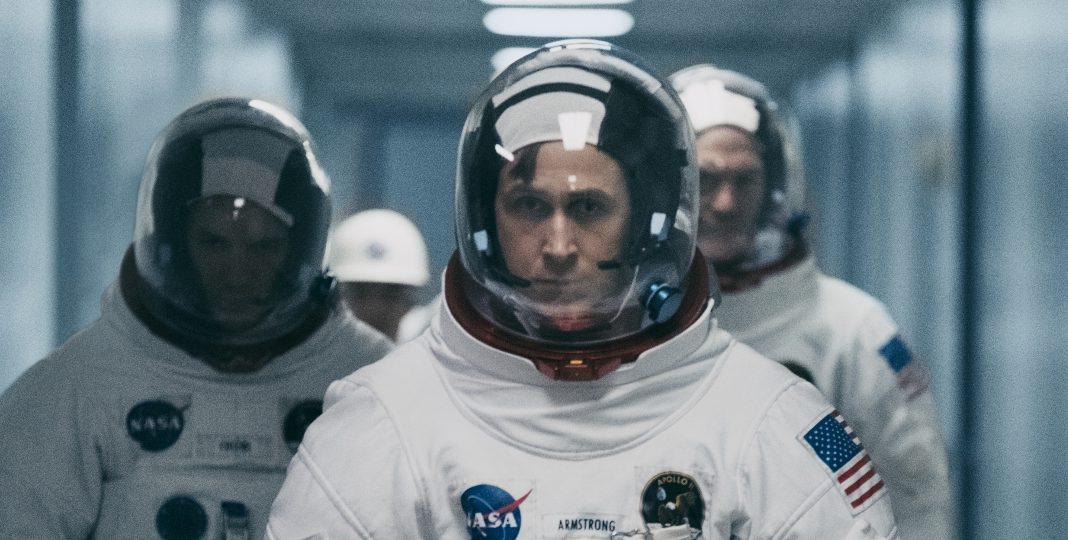 First Man (L to R) LUKAS HAAS as Mike Collins, RYAN GOSLING as Neil Armstrong and COREY STOLL as Buzz Aldrin in